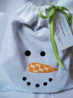 Handmade gift: Snowman Kit - the kit includes a top hat, scarf, buttons, painted rocks, and a fake carrot nose! tucked into a decorative (diy) drawstring bag. I just like the bag!