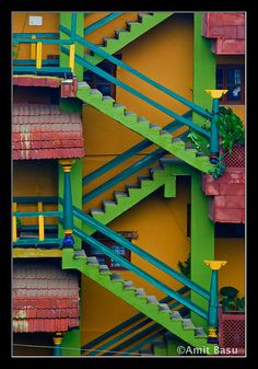 Colorful set of staircase seen someplace in Bangalore, India. I have not seen any other like this in India, but then, I haven't lived in the state of Kerala, where houses are known to be rather colorful. :-)