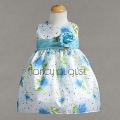 Sassy Flower Print Girls Dress: This turquoise flowered girl dress is a refreshing print just in time for the Spring! This casual dress features a fun flower print with cute colorful dots. The poly cotton blend fabric pairs brilliantly with a beautiful contrasting waist sash accented with a detachable flower. This girls dress is conveniently available in baby, toddler and matching girl sizes. A perfect choice as a flower girl dress for all the popular summer weddings these days.