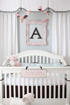 Beautiful nursery! Aqua, white, brown, and pink.