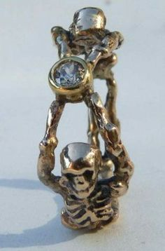 """memento mori"" skeleton ring. want."