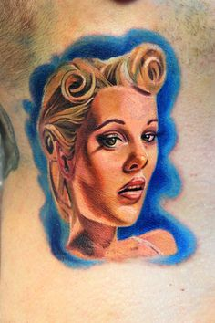 Little pin-up girl head on neck  Electrographic tattoo Rosenheim ,Bayern , Germany