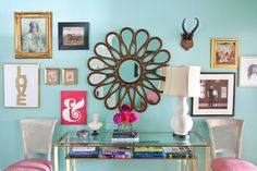 Cheery & eclectic foyer by designer Caitlin Wilson.  Wall color is Key Largo Green by Benjamin Moore.