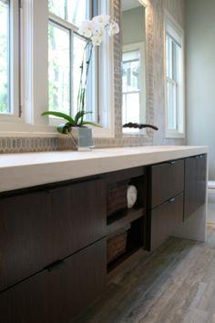 Rethink Design Studio: Gorgeous contemporary bathroom design with espresso floating vanity, white counter tops, ...