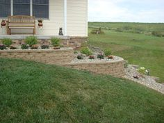 Dishing Up Design: DIY Retaining Wall & Landscaping - Modern Retaining Wall Bricks, Small Retaining Wall, Retaining Wall Design, Garden Retaining Wall, Landscaping Retaining Walls, Landscaping Plants, Front Yard Landscaping, Landscaping Ideas, Steep Hillside Landscaping