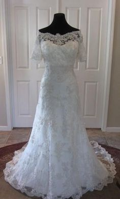 Casablanca 2119: buy this dress for a fraction of the salon price on PreOwnedWeddingDresses.com