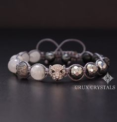 Hand Crafted Mens Natural Stone Shamballa Bracelet made of 10mm mixed natural stone beads - Faceted White Quartz Crystal, Faceted Silver Hematite, Snowflake Obsidian, and Gray Map Jasper, all combined with dark grey waxed shamballa cord. The item ends with two Faceted Gray Hematite beads