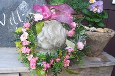 Engel mit Kranz aus Rosen - Wohnen und Garten Foto