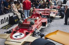 Jochen Rindt and Emerson Fittipaldi sit on the pitwall in front of their Lotus Ford and Lotus Ford respectively. Lotus F1, Jochen Rindt, Lancia Delta, Automobile, Modified Cars, Car And Driver, Formula One, Courses, Car Pictures