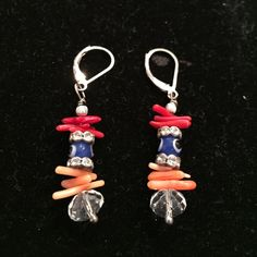 Multi-Colored & Silver Dangling Earrings Multi-colored Silver-plated dangling earrings. Colors are coral, orange and a blue evil eye surrounded by cubic zirconia. Great to wear all year round. They are very comfortable and affordable too! Jewelry Earrings