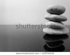 597e18a38 Balanced zen stones on a black table against grey background. Concept of  harmony