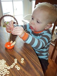 Spaghetti beading is a fun fine motor activity for your little one. Roll a ball of Play Doh, stick dry spaghetti noodles in the ball, and give him some Cheerios or Fruit Loops. :) Good times.