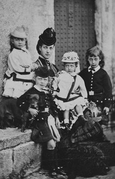 Princess Alexandra, Princess of Wales with her four oldest children: Princess Louise, Prince George, Princess Victoria and Prince Albert Victor. September 1870.