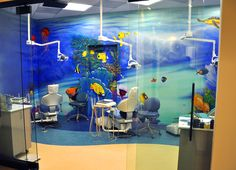 """Underwater reef"" mural with dental chairs installed."