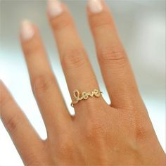 """We're still obsessing over this dainty #love ring by Sydney Evan via @thomaslainejewelry it'd look sooo pretty next to an engagement ring don't you…"""