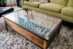 DIY display table (not Legos though) - this is definitely a great idea for a coffee table for my living room. I could make a tiny housing development in it. I'd want a removable top though so I could play with it when I want...