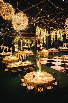 An outdoor black tie wedding ceremony with gorgeous golden lights and tablescapes love the balls wound with faith lights