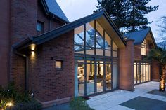 For bespoke conservatories, orangeries and glazed extensions, visit Viva today. Gable Roof Design, Modern Lodge, Timber Walls, Glass Extension, Glass Structure, Pergola, Cladding, Architecture Design, Brick