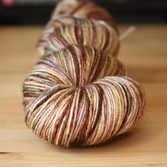 """Only one skein in silk/merino: """"portobello"""" is an unrepeatable colorway in earthy neutrals with touches of moss, silver and gold. 437 yards of hand dyed silk/merino wool by phydeaux designs."""