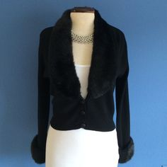 New ListingCropped Black Sweater Cardigan This gorgeous, cropped, sweater jacket is perfect for any special occasion.  The faux fur collar and cuffs make a statement.  Material:  100% Merino Wool Donna Morgan Sweaters Cardigans