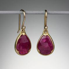 This stunning pair of yellow gold earrings features two beautiful bezel set pear-shaped rose cut rubies in a deep fuchsia color with Gabriella Kiss' signature scalloping.The total length of these Gabriella Kiss earrings is approximately Ruby Earrings, Ruby Jewelry, Gold Jewelry, Diamond Earrings, Jewelry Accessories, Jewelry Design, Fine Jewelry, Jewellery Box, White Gold Bridal Jewellery