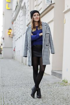 Shop this look on Lookastic:  http://lookastic.com/women/looks/beanie-crew-neck-sweater-mini-skirt-coat-ankle-boots-tights/8199  — Black Beanie  — Blue Crew-neck Sweater  — Black Leather Mini Skirt  — White and Black Houndstooth Coat  — Black Leather Ankle Boots  — Black Tights