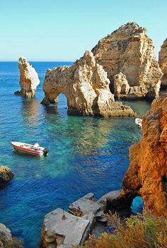Ponta da piedade Algarve  Portugal- My family and I stood on that platform to get on a fishing boat that would take us through those rocks and caves