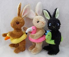 3 in a row: Bunny rabbits with swim rings on