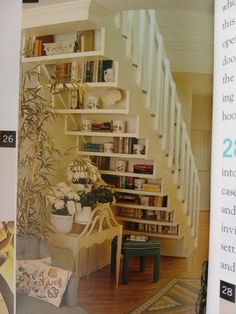 Shelves under stairs = great reading nook.  Don't know if this would be practical for us, but it's a neat idea.