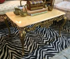 Elegant Brass Base Marble Top Coffee Table  $225  Eclectic Treasures Booth #8279  Lula B's  1010 N. Riverfront Blvd. Dallas, TX 75207