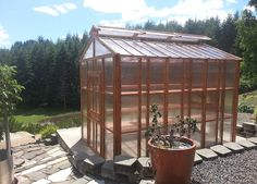 Custom Modern Slant roof greenhouse.  NW Green Panels