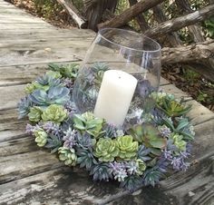 I have wreaths on the brain lately and I am loving these succulent wreaths.  They are so beautiful and unconventional.