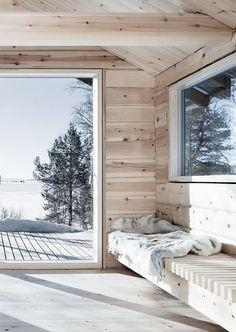 Aslak Haanshuus transforms two Norwegian log cabins into a cross-shaped house