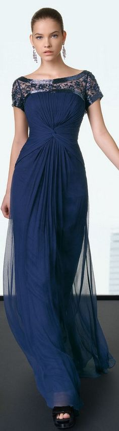 I like the bright color and how the gown twists in the center and billows away - very classic, yet fresh.