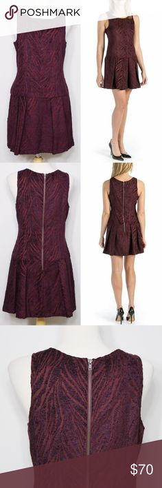 "Free People Chenille Zebra Pleated Dropwaist Dress Bust: 19"" (laying flat) Length: 34"" (shoulder to hem)  Burgundy and purple pleated drop waist skirt. Purple velvet zebra stripes decorated all over. Exposed zipper on back. Front pockets. Rayon/polyester. Scoop neck and Sleeveless. No holes or stains. Comes from a smoke free environment. Free People Dresses"