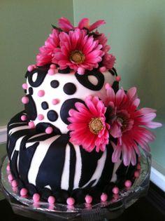 My first fondant cake - Hot Pink Zebra! - This was my first fondant cake and will be my daughter's college graduation cake next month.