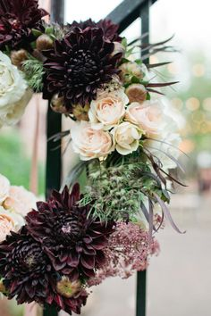 gorgeous wreath for church doors or entry gate. Huge chocolate dahlias, blush roses and mixed fillers and foliage's the match