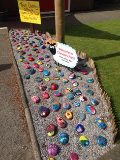 Every child decorates a stone and then adds a weatherproofing varnish. What an amazingly welcoming display!