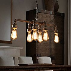 Light up your home Industrial style, with these beautiful finds. Pick from standing pulley lamps, industrial wall lights, industrial hanging lights and marquee retro lighting. Industrial Hanging Lights, Industrial Style Lighting, Industrial Chandelier, Industrial Light Fixtures, Hanging Light Fixtures, Retro Lighting, Industrial Pipe, Industrial Dining, Lighting Ideas