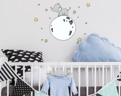 a dreamy wall decal for your little ones nursery!  This decal set comes with one large decal of the elephant on the moon, which measures 23 x 25 inches, along with 5 extra stars to place around it wherever you wish.  It is a lightweight fabric wall decal that is safe to put on a clean, non-porous wall and can be easily repositioned many times.    Visit the rest of my shop here: https://www.etsy.com/shop/SweetMelodyDesigns