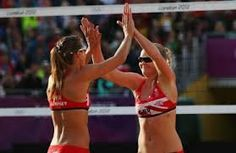 Olympic beach volleyball players 'glistening like wet otters'
