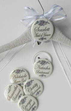 Personalised Bride/Bridesmaid dress hangers with detachable badge which can be worn on the Hen Night, pretty ribbon and handmade paper flower