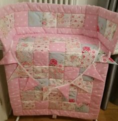 This Shabby Chic cot or cot bed quilt is handmade to order from a selection of 5 Cath Kidston Fabrics. Beautiful Pinks, Turquoises and Blues have been teamed together. Backed with a Snow white 100% cotton fabric and quilted with a 4 oz wadding. Makes a lovely gift for a new baby or your special little Princess. Measures approximately :- 115 cm x 90 cm :) Completed within 2 weeks of order Additional items such as :- Bumper 32.00 GBP, Cushion cover 16.00 GBP, Bunting 16.00 GBP for 8 flags or…