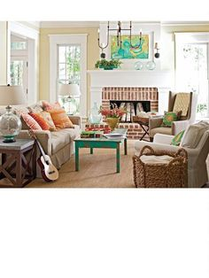 "I just love how ""lived-in"" and homey this room looks (and the fireplace!)! :) [Better Homes & Gardens - February 2011]."