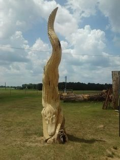 Beneath the Bark Chainsaw Carvings