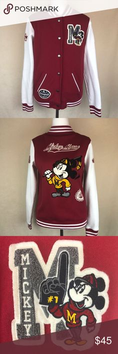 """Mickey Mouse U Varsity Jacket Disneyland Park Disney Parks Mickey Mouse Varsity Jacket. Size medium. Patches on both sleeves and two on front. Textured velvet print Mickey on back. Front pockets. Gently used, no flaws. Measurements laid flat armpit to armpit: 19"""". Length: 25.5"""". Sleeve length: 25"""".  Not marked if men or women's, so please check measurements. Unisex? Disney Jackets & Coats"""