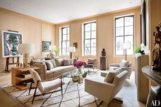 White-oak paneling lines the New York City living room of architect Steven Harris and designer Lucien Rees-Roberts