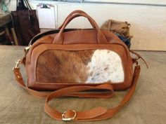 Handmade Doctor Bag Cow Hide purse made by Oleta Corry. Learn more about this #jacksonhole artisan at our blog.