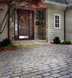 Belgard Old World Cobble Driveway, Flagstone and Natural Stone Veneer Surround Entrance.