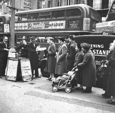 Bus in central london but on its way to Chiswick! (Evening Standard sellers) 1950s